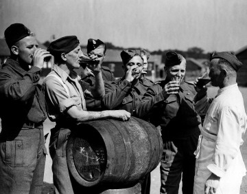 B4K8K5 British troops released from a German prison camp 1944 drinking English beer for the first time in four years WW2